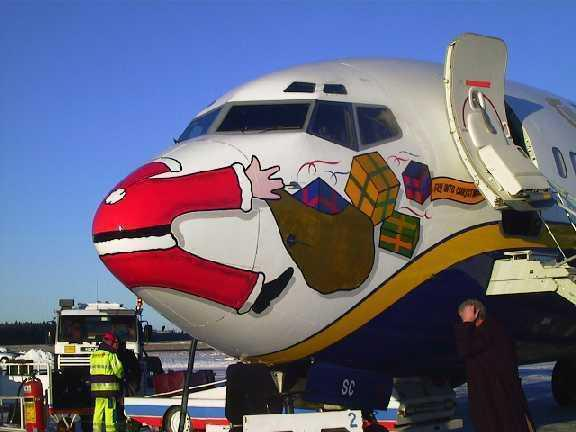 santa splotted on plane nose 122412