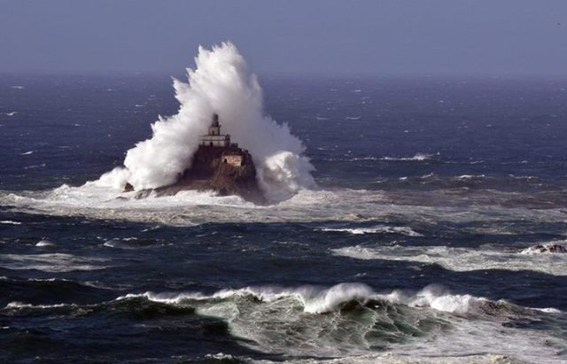 Waves crashing into Tillamook Rock Lighthouse on the Oregon Coast - by Jim Scott