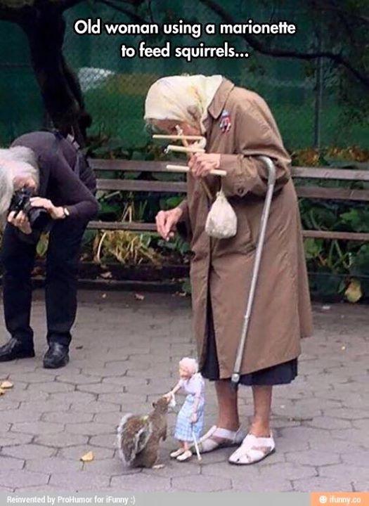Stara Baba puppet feeding squirrels